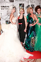 Fashion designer Amal Sarieddine poses with models on the red carpet after her Amal Sarieddine Spring 2012 fashion show; at the Waldorf Astoria Hotel in New York City, during Couture Fashion Week, September 16, 2011.