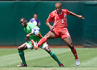 05 July 2009:  Luis Moreno of the Panama tries to control the ball away from Loic Loval of the Guadeloupe during the game at Oakland-Alameda County Coliseum in Oakland, California.   Guadeloupe defeated Panama, 2-0.