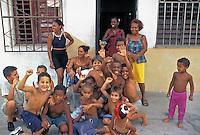 Children smiling waving Cienefugeous Cuba, Republic of Cuba,