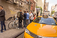 Graffiti enthusiasts flock to the corner of West 24 Street and Sixth Avenue in the New York neighborhood of Chelsea on Thursday, October 3, 2013 to see the third installment of Banky's graffiti art. The elusive street artist will be creating works around the city, one each day, during the month of October accompanied by a satirical recorded message parodying a museum tour which you can get by calling the number 1-800-656-4271 followed by  # and the number of artwork.  (© Richard B. Levine)