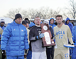 3 December 2006: UCLA's Kiel McClung (17), Eric Reed (22) and head coach Jorge Salcedo (left) pose with the NCAA runner-up trophy during postgame ceremonies. California-Santa Barbara defeated California-Los Angeles 2-1 at Robert R. Hermann Stadium in St. Louis, Missouri in the NCAA men's college soccer tournament final game to win the 2006 NCAA Championship.