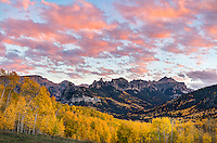 Uncompahgre National Forest, Colorado: Sunset clouds over the cliffs of the Cimarron range and fall aspen groves