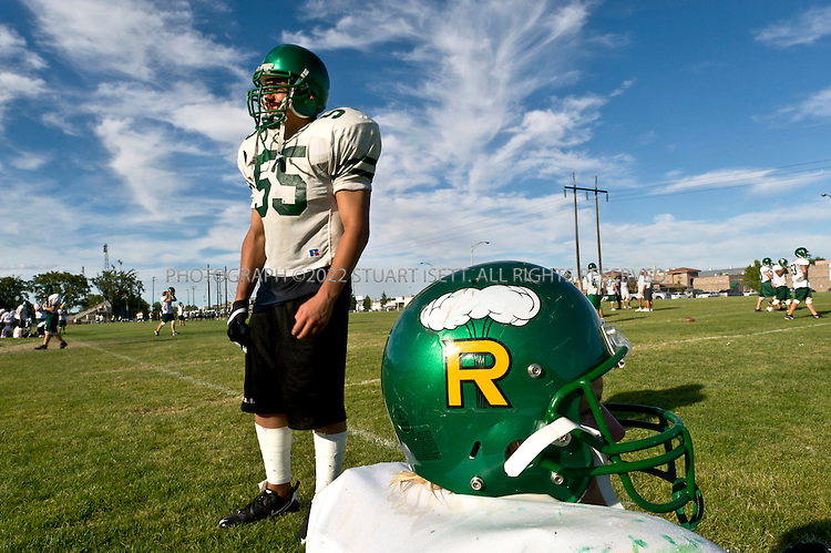 8/28/2008--Richland, WA, USA..The Richland High School football team at practise. In the fall of 1945, after an atomic bomb was dropped on Nagasaki, students changed the team's mascot to a mushroom cloud and called themselves the 'Bombers'. The plutonium that was in that bomb was manufactured by workers at nearby Hanford Nuclear Site as part of the Manhattan Project. ..During the Cold War, the Hanford project was expanded to include nine nuclear reactors and five massive plutonium processing complexes, which produced plutonium for most of the 60,000 weapons in the U.S. nuclear arsenal. The weapons production reactors were decommissioned at the end of the Cold War, but the manufacturing process left behind 53 million U.S. gallons of high-level radioactive waste that remains at the site. Hanford is the most contaminated nuclear site in the United States and is the focus of the nation's largest environmental cleanup, providing thousands of jobs to residents in nearby towns such as Richland...©2008 Stuart Isett. All rights reserved.