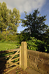 Five bar wooden gate leading to country trail in spring time, North Yorkshire, England.