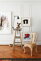 Contemporary art mixed with vintage finds is a recurring theme in the apartment as seen here in the living room