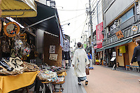 """Yanaka Ginza shopping arcade, Yanaka, Tokyo, Japan, April 19, 2012. Yanaka is part of Tokyo's """"shitamachi"""" historic working class wards. Recently it has become popular with Japanese and foreign tourists for its many temples, shops, restaurants and relaxed atmosphere."""
