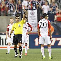 Yellow Card: Toronto FC midfielder Matias Laba (20). In a Major League Soccer (MLS) match, Toronto FC (white/red) defeated the New England Revolution (blue), 1-0, at Gillette Stadium on August 4, 2013.