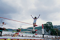 One of the Luchadoras (women wrestlers), looks for cheers from the crowda after throwing Diabolica onto the mat.  Interaction with the public is very important in Lucha Libre.  Ecatepec, Estado de Mexico.  June, 2004