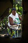 Faria Benoit shovels debris from an earthquake-damaged house in Mellier, Haiti. The dwelling will soon be replaced with a new house provided by the United Methodist Committee on Relief (UMCOR).