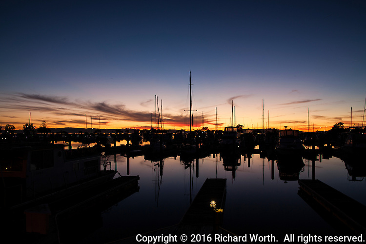 Night falls slowly and quietly on the boats moored at the San Leandro Marina on San Francisco Bay's eastern shores.