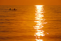 A pair of canoeists on Lake Superior at dusk in Lake Superior Provincial Park near Wawa, Ontario.