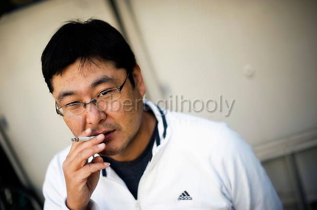 Toyoki Toshida, a suicide and credit counselor, outside his office in Saitama, just north of Tokyo, Japan. Drowning in debt, Yoshida attempted to take his own life 7 years ago, but today tries to stop others in similar situations from committing suicide on 06 Nov. 2009.