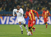 Kwadwo Asamoah of Ghana and Maurice Edu of USA. Ghana defeated the USA 2-1 in overtime in the 2010 FIFA World Cup at Royal Bafokeng Stadium in Rustenburg, South Africa on June 26, 2010.