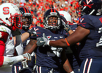 UVa runningback Jason Snellings, middle, is celebrated by his teamates for a 1st quarter touchdown against NC State Saturday at Scott Stadium in Charlottesville, VA.