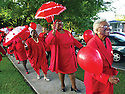 Pentecost celebration at Bethany Pentecostal Church, 2002<br /> <br /> <br /> Bernie Y. Miller and her daughter Juanita Miller lead the second line at Bethany United Methodist Church which held a Pentecost celebration, Sunday, May 19, 2002