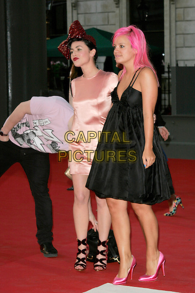 ALFIE ALLEN, JAMIE WINSTONE & LILY ALLEN.The Royal Academy of Arts Summer Exhibition 2008 preview party at Royal Academy of Arts in London, England..June 4th, 2008.full length black dress strappy shoes satin silk red bow ribbon in hair pink accessory jaime couple black trousers  purple t-shirt sister brother siblings hiding face head bending leaning funny dyed hair .CAP/AH.©Adam Houghton/Capital Pictures.