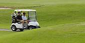 Kailua, Hawaii - December 29, 2008 -- United States President-elect Barack Obama (right) drives his golf cart with his Punahou School classmate Greg Orme (left) as they play golf with friends in Kailua, Hawaii on Monday, December 29, 2008. Obama and his family arrived in his native Hawaii December 20 for the Christmas holiday..Credit: Joaquin Siopack - Pool via CNP