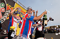 Jul. 28, 2013; Sonoma, CA, USA: NHRA pro stock motorcycle rider Hector Arana Jr sprays champagne as he celebrates with his crew after winning the Sonoma Nationals at Sonoma Raceway. Mandatory Credit: Mark J. Rebilas-