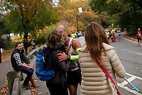 A Runner embraces a relative as she attends the annual TCS New York City Marathon in Central Park New York 01.11.2015. Mary Keitany wins second consecutive NYC Marathon, Stanley Biwott is men's winner. Ken Betancur/VIEWpress.