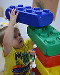"""Gunner, 3, builds a """"clubhouse"""" out of large colored blocks while at Leslie Early Head Start childcare on October 11, 2013 in Hyden, Kentucky.  The daycare is funded entirely by the government, and could be in jeopardy if the government shutdown continues."""