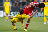 3 JULY 2010:  Wilman Conde of Chicago Fire (22) takes down Guillermo Barros Schelotto of the Columbus Crew (7) during MLS soccer game between Chicago Fire vs Columbus Crew at Crew Stadium in Columbus, Ohio on July 3, 2010.