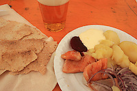 Fermented freshwater fish, rakfisk. A tradition in Norway. Served with sourcream, raw onions, potetoes, flat bread, bear and akkevit (aqva vitae).