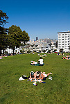 California: San Francisco. People relaxing in Alamo Square with view of Victorians and modern downtown. Photo copyright Lee Foster. Photo #: san-francisco-alamo-square-20-casanf79140