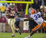 Florida State quarterback Deondre Francois, runs past Florida linebacker David Reese ll in the second half of an NCAA college football game in Tallahassee, Fla., Saturday, Nov. 26, 2016. Florida State defeated Florida 31-13.  (AP Photo/Mark Wallheiser)