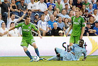 Zach Scott (20) defender Seattle Sounders has the ball with C.J Sapong (17) forward Sporting KC on the ground..... Sporting Kansas City were defeated 1-2 by Seattle Sounders at LIVESTRONG Sporting Park, Kansas City, Kansas.