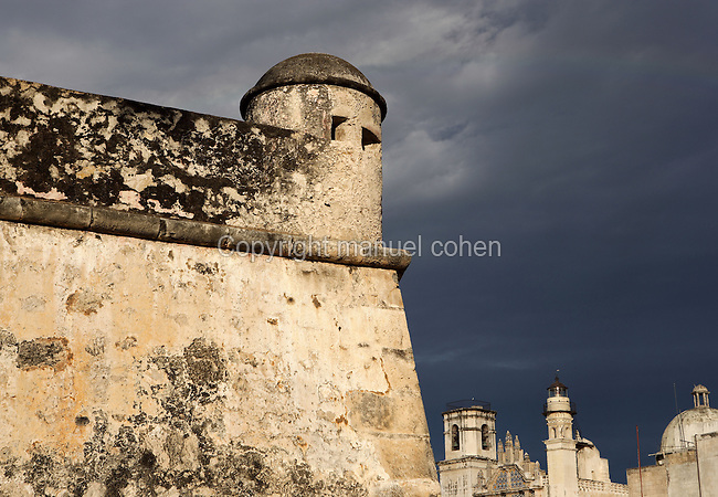 Fort of San Carlos, beginning of the 17th century, church of San Francisco in the distance. At present houses City Museum showing the defense system of the walled city of Campeche, Yucatan, Mexico Picture by Manuel Cohen