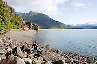 Stephanie Haynes leaving the shores of Kachemak Bay as she begins hiking up the Saddle and Alpine Ridge trail in Kachemak Bay State Park, near Homer, Alaska.