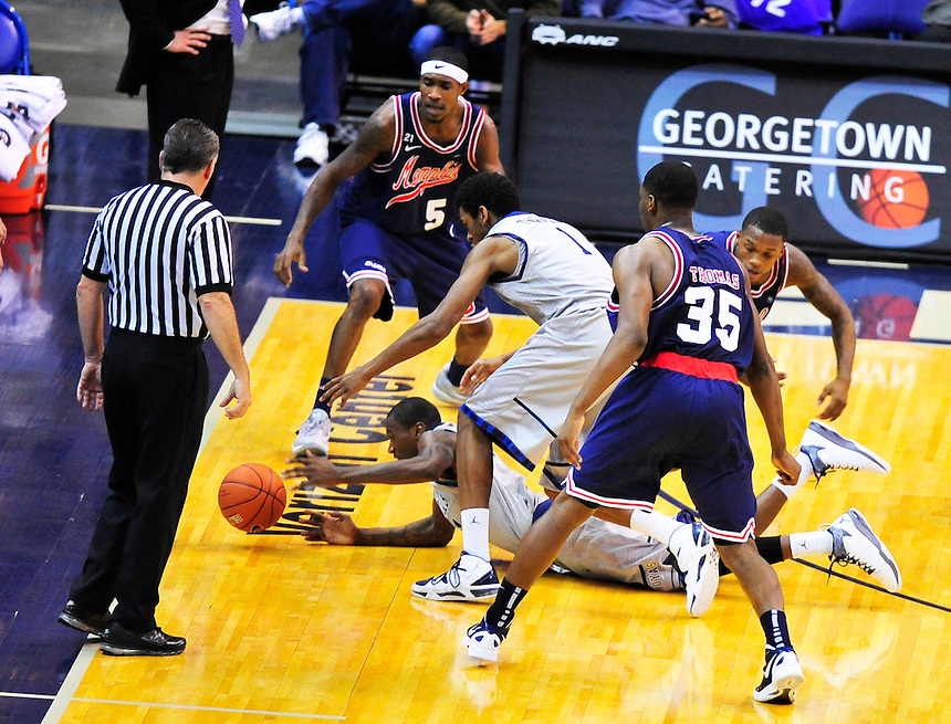 Players from both sides has a tough time controlling the ball. Georgetown defeated Memphis 70-59 at the Verizon Center in Washington, D.C. on Thursday, December 22, 2011. Alan P. Santos/DC Sports Box