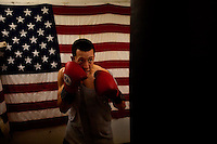 An unidentified man works the heavy bag at a boxing gym near the Houston Shipping Channel in 2011.
