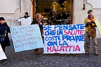 Roma, 23  Febbraio 2015 <br /> Manifestazione di lavoratori della sanit&agrave;, a rischio licenziamento dell' Aurelia Hospital, della European Hospital e della casa di Cura Citt&agrave; di Roma, dopo i 160 licenziamenti collettivi avviati dalla propriet&agrave;  e altri 2000 lavoratori rischiano il licenziamento perch&egrave; la Regione Lazio ha tagliato i fondi per le prestazioni salvavita. I lavoratori fanno il funerale alla sanit&agrave; davanti a Montecitorio<br /> Rome, February 23, 2015<br /> Demonstration by health workers, at risk of dismissal of the Aurelia Hospital, the European Hospital and Home Care City of Rome, after 160 redundancies initiated by property,another 2000 workers risk dismissal because the Lazio Region has cut funds for life-saving performance. The workers make the funeral to the Health in front of Deputies