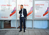 &copy; Licensed to London News Pictures. 27/09/2011. LONDON, UK. A delegate on a phone outside the Jury's Inn hotel at The Labour Party Conference in Liverpool today (27/09/11). Photo credit:  Stephen Simpson/LNP
