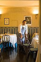 Portrait of chef Ciccio Sultano in the dining room of the II Duomo restaurant in Ragusa Ibla
