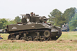 """Reenactors showcase World War II tanks, half-tracks and support vehicles during the Museum of the America G.I.'s annual Open House on March 29, 2008 in College Station, Texas. This vehicle is a M5A1 Stuart Tank named """"Suzie."""""""