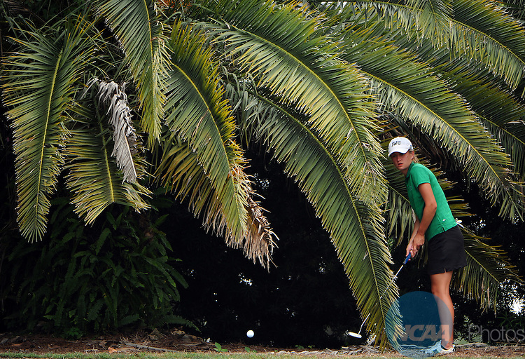 13 MAY 2011: Katie Klosterman of Illinois Wesleyan University chips from the rough during the Division III Women's Golf Championship held at the El Campeon Golf Course in Howey-in-the-Hills, FL.  Methodist University won with a total score of 966. Joshua Duplechian/NCAA Photos