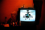 An Apache helicopter on a television in Casa Argentina, a low-rate hostel for backpackers in the Guatemalan highland town of Xela (Quetzaltenango)