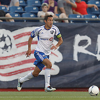 Montreal Impact forward Davy Arnaud (22) brings the ball forward. In a Major League Soccer (MLS) match, Montreal Impact defeated the New England Revolution, 1-0, at Gillette Stadium on August 12, 2012.