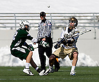 Eric Lusby (12) of Loyola fights for the ball with Joe Lennon (22) of Navy at the Navy-Marine Corp Memorial Stadium in Annapolis, Maryland.   Loyola defeated Navy, 8-7, in overtime.