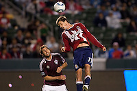 CD Chivas USA forward Justin Braun (17) leaps high over Rapids midfielder Brian Mullan (11). The Colorado Rapids defeated CD Chivas USA 1-0 at Home Depot Center stadium in Carson, California on Saturday March 26, 2011...