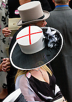Race-goer wearing a hat showing the St George's flag for England at Royal Ascot Races