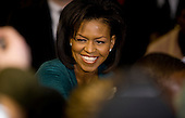 "Washington, DC - January 19, 2009 -- Michelle Obama, wife of U.S. President -elect Barack Obama take parts in  ""Operation Gratitude"" a public service event at RFK Stadium in Washington, D.C., Monday, January 19, 2009..Credit: Mannie Garcia - Pool via CNP"