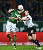 USSBALL   1. BUNDESLIGA    SAISON 2012/2013    10. Spieltag   Werder Bremen - FSV Mainz 05                             04.11.2012 Nils Petersen (li, SV Werder Bremen) gegen Radoslav Zabavnik (1. FSV Mainz 05)