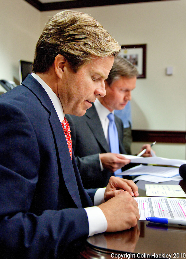 TALLAHASSEE, FLA. 11/4/10-OVERRIDE 110410 CH-Incoming Senate President Mike Haridopolos, R-Melbourne, left, and Incoming House Speaker Dean Cannon, R-Winter Park, look over the list of vetoes signed by Gov. Charlie Crist that they hope to override during the Nov. 16th Organizational Session, Thursday a news conference at the Capitol in Tallahassee. .COLIN HACKLEY PHOTO