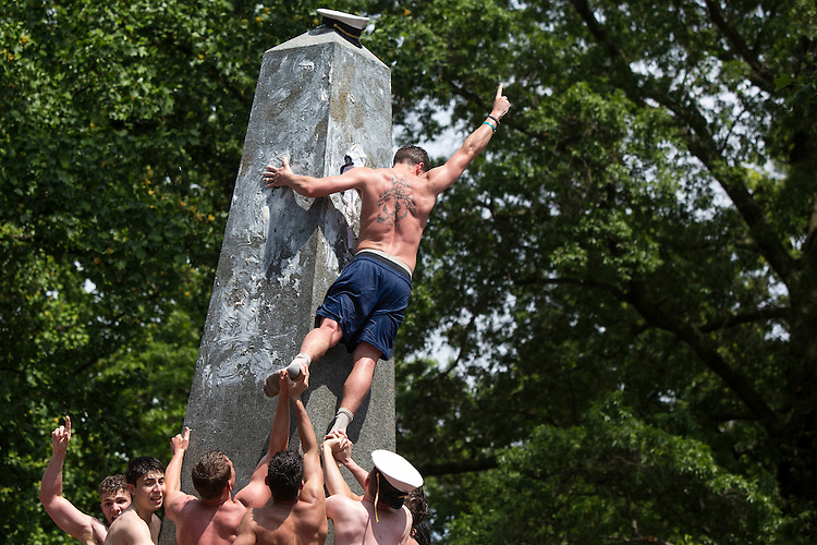 UNITED STATES - MAY 23 - Midshipman 4th Class Chris Bianchi, celebrates after placing a midshipman cover after 1 hour 12 minutes 30 seconds on top of the Herndon Monument, during a finale to their first year at the U.S. Naval Academy, in Annapolis, Md., Monday, May 23, 2016. Plebes are tasked with working together to summit the 21 foot monument, which is covered with 50 pounds of vegetable shortening, and replacing the dixie cap on the top with a midshipman cover. (Photo By Al Drago/CQ Roll Call)