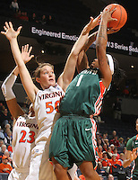 Jan. 6, 2011; Charlottesville, VA, USA; Miami Hurricanes guard Riquna Williams (1) shoots the ball next to Virginia Cavaliers forward Chelsea Shine (50) during the game at the John Paul Jones Arena.  Mandatory Credit: Andrew Shurtleff-