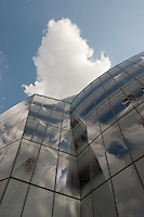 Clouds and glass building in New York City