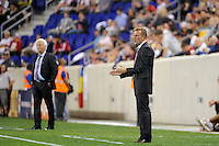 Real Salt Lake head coach Jason Kreis gives instructions. Real Salt Lake defeated the New York Red Bulls 3-1 during a Major League Soccer (MLS) match at Red Bull Arena in Harrison, NJ, on September 21, 2011.